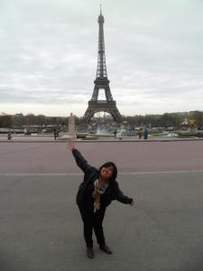 Photo of Justher in front of the Eiffel Tower